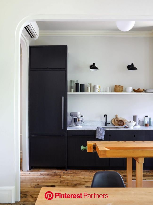 Warm minimalism in a young architect's own Brooklyn townhouse renovation   Black kitchen cabinets, Black kitchens, Kitchen cabinet design